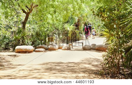 Indian Family take a stroll along a trail