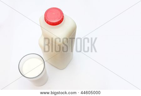 Glass Of Milk With Carton Behind