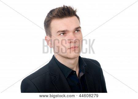 Close-up Portrait Of A Pensive Young Business Man.