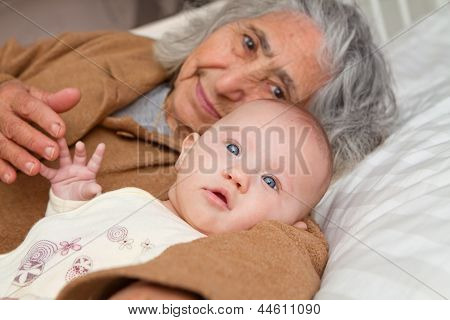 Great Grandma Laying Down With Baby