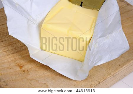 Block of butter in wrapping.