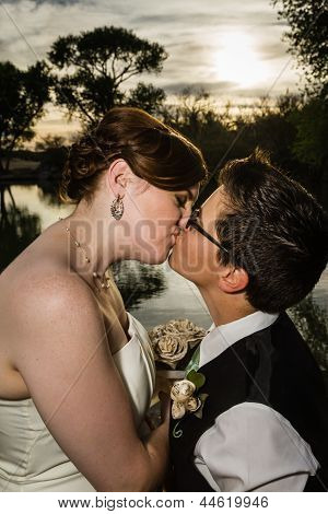 Kissing Married Couple By Lake