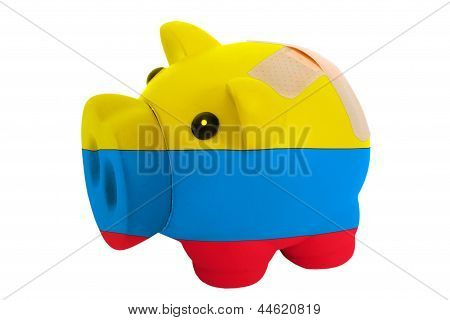Closed Piggy Rich Bank With Bandage In Colors National Flag Of Columbia