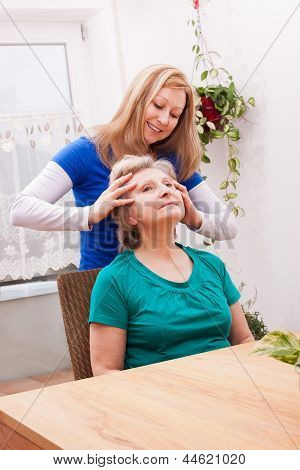 Young Woman Massaging Female Seniors Scalp