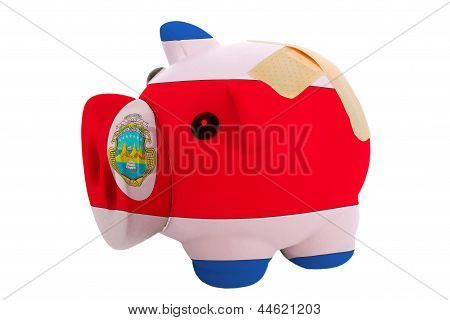 Closed Piggy Rich Bank With Bandage In Colors National Flag Of Costarica