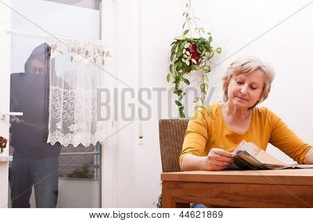 Senior Does Not Note The Burglar