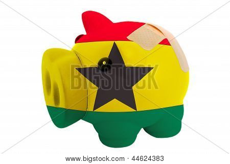 Closed Piggy Rich Bank With Bandage In Colors National Flag Of Ghana