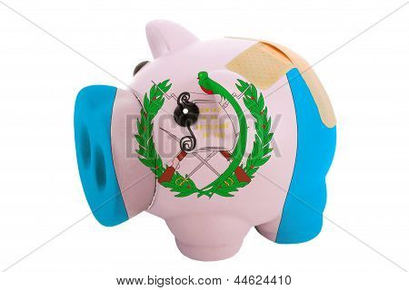 Closed Piggy Rich Bank With Bandage In Colors National Flag Of Guatemala