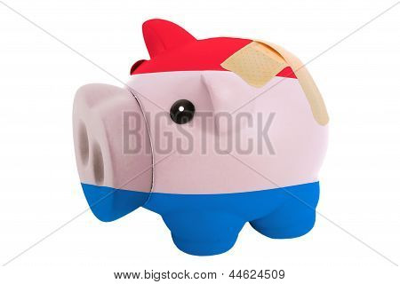 Closed Piggy Rich Bank With Bandage In Colors National Flag Of Holland
