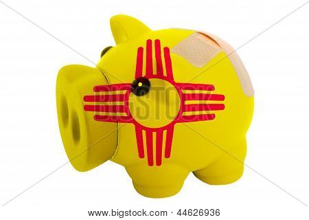 Closed Piggy Rich Bank With Bandage In Colors Flag Of American State Of New Mexico