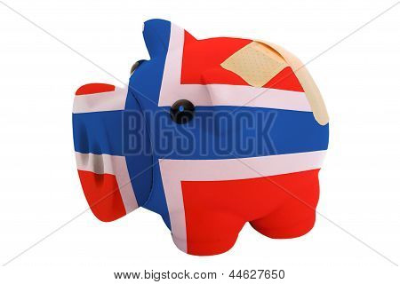 Closed Piggy Rich Bank With Bandage In Colors National Flag Of Norway