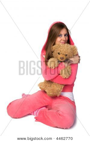 Young Beautiful Woman In The Pink Sportswear With Teddy Bear