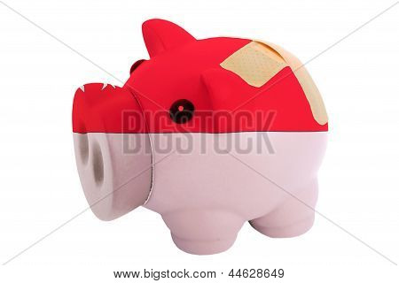 Closed Piggy Rich Bank With Bandage In Colors National Flag Of Singapore