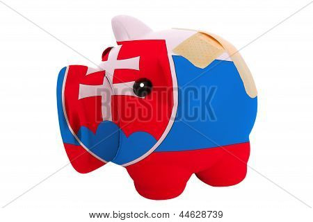 Closed Piggy Rich Bank With Bandage In Colors National Flag Of Slovakia