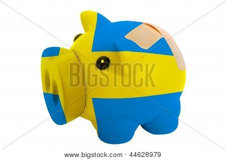 Closed Piggy Rich Bank With Bandage In Colors National Flag Of Sweden