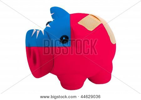 Closed Piggy Rich Bank With Bandage In Colors National Flag Of Taiwan