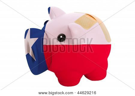 Closed Piggy Rich Bank With Bandage In Colors Flag Of American State Of Texas
