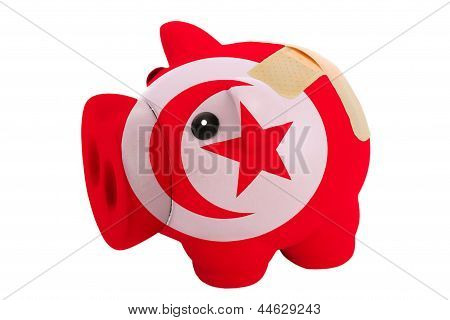 Closed Piggy Rich Bank With Bandage In Colors National Flag Of Tunisia