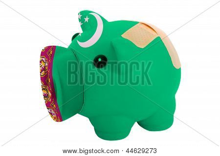 Closed Piggy Rich Bank With Bandage In Colors National Flag Of Turkmenistan