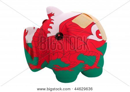 Closed Piggy Rich Bank With Bandage In Colors National Flag Of Wales