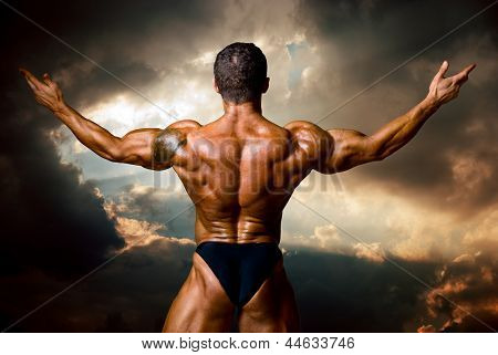 Man With His Arms Wide Open Outdoor Against Storm Dark Clouds