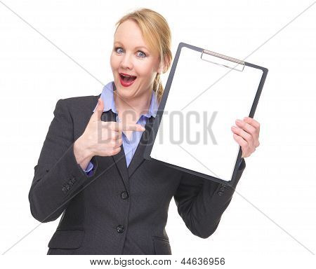 Portrait Of A Happy Businesswoman Pointing To Blank Sign Clipboard