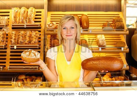 Bakery Shopkeeper With Two Loafs Of Bread