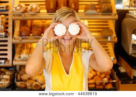 Bakery Shopkeeper Covers Eyes With Meringue
