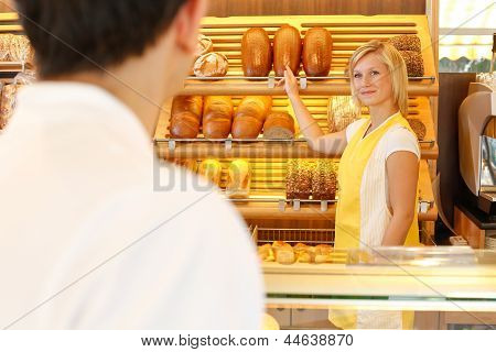 Shopkeeper In Baker's Shop With Customer