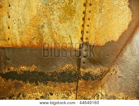 Rusted Metal Background With Rivet Holes And Seams