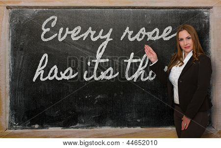 Teacher Showing Every Rose Has Its Thorn On Blackboard
