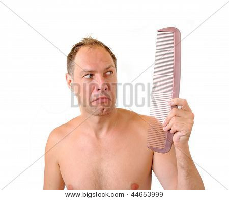 Surprised Man Hand Holding Comb Near The Head