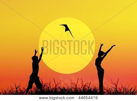Earth day.Children play on a sunset background