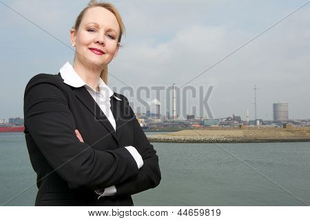 Confident Business Woman Standing Outside Construction Site