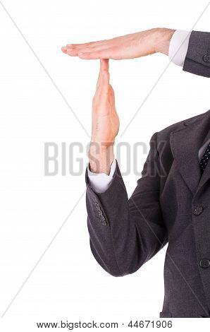 Businessman showing time out sign with hands.