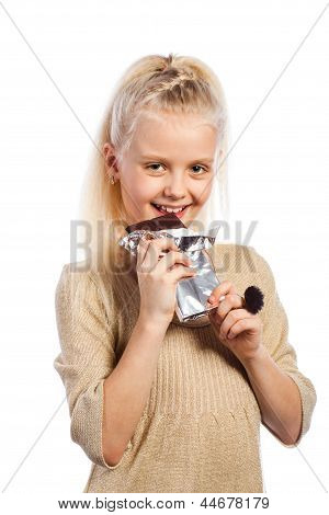 Beautiful girl biting chocolate.