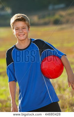 Cute Boy With Soccer Ball Outdoors.