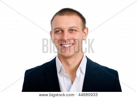 Close-up Portrait Of A Happy Successful Businessman. Looks Aside.