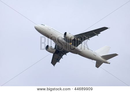 Plane taking off to the sky
