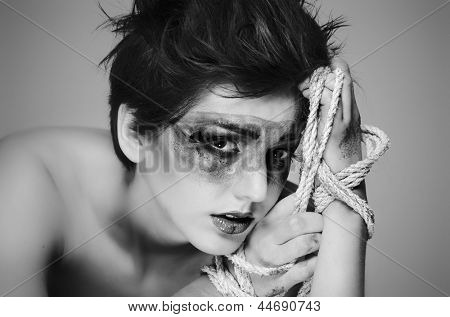Concept image of wounded woman constrained, tied up.