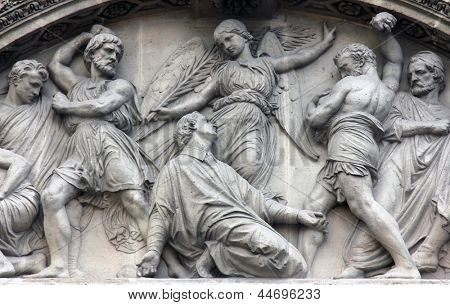 The Martyrdom of St. Stephen pediment of the front door of the Saint Etienne du Mont Church, Paris.