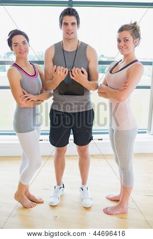 People standing at the gym smiling in fitness studio