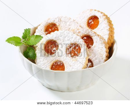 linzer cookies in a bowl