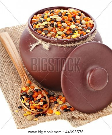 crock pot with lentil in sackcloth canvas napkin isolated on white background