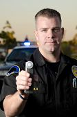 stock photo of sobriety  - A police ofifcer holding the breath test machine on a stop - JPG