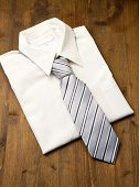 New White Man's Shirt And Tie Isolated On Wood