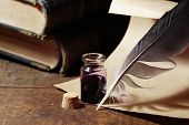 image of inkpot  - Vintage still life with inkpot and feather near scroll and books - JPG