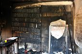 stock photo of morbid  - Burned books and furniture after a house fire - JPG