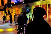 foto of tv sets  - Cameraman works in the TV studio  - JPG