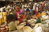 pic of barter  - Crowded outdoor market during a Hindu religious festival at Orchha Madhya Pradesh India - JPG